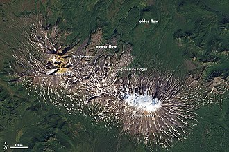 Volcanoes of Kamchatka - This Landsat photo illustrates volcanic features of recent flows at Zhupanovsky and  Dzenzursky volcanoes.