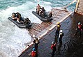 Zodiak boats enter the stern gate of the USS Gunston Hall.jpg