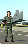 050623-F-9032T-014 Capt. Nicole Malachowski, female fighter pilot from LAKENHEATH pose in front of her F-15E Strike Eagle.jpg