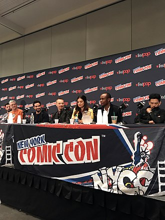 The Exorcist (TV series) - Cast and crew of the series at the 2017 New York Comic Con. From left to right: Producer/writers Jeremy Slater and Sean Crouch; actors Alfonso Herrera, Ben Daniels, Zuleikha Robinson, Kurt Egyiawan, and John Cho.