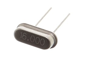 Crystal oscillator - A miniature 16 MHz quartz crystal enclosed in a hermetically sealed HC-49/S package, used as the resonator in a crystal oscillator.