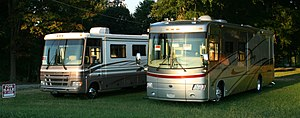 English: A pair of recreational vehicles for s...