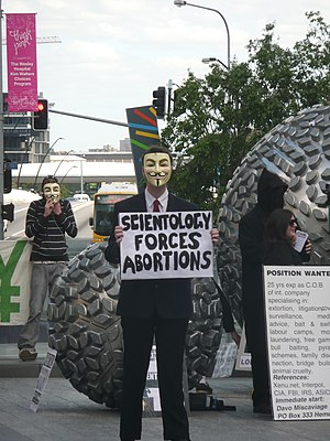 "Protest sign: ""Scientology Forces Abortio..."