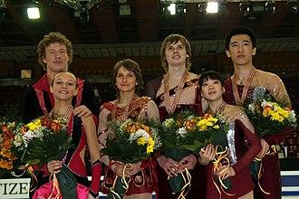 2008 World Junior Figure Skating Championships - The pairs podium. From left: Lubov Iliushechkina / Nodari Maisuradze (2nd), Ksenia Krasilnikova / Konstantin Bezmaternikh (1st), Dong Huibo / Wu Yiming (3rd).