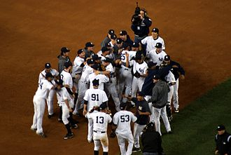 2009 American League Championship Series - New York Yankees celebrate after their 5–2 win against the Los Angeles Angels of Anaheim.