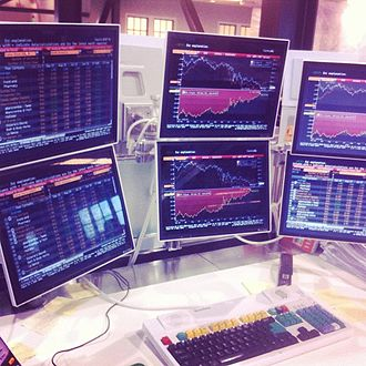Bloomberg Terminal - A Bloomberg terminal with a multi-monitor set-up composed of six screens.