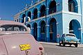 2 Old Cars and a blue building, Matanzas, Cuba (5978489954).jpg
