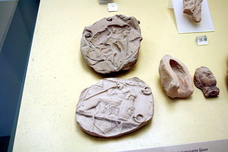 Molding (process) - Ancient Greek molds, used to mass-produce clay figurines, 5th/4th century BC. Beside them, the modern casts taken from them. On display in the Ancient Agora Museum in Athens, housed in the Stoa of Attalus.