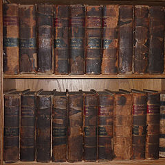 Very old books on shelves