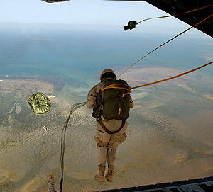 449th Air Expeditionary Group - A pararescueman from the 131st Rescue Squadron jumps from an HC-130 during a training mission recently. The 131st works with the 449th Aor Expeditionary Group