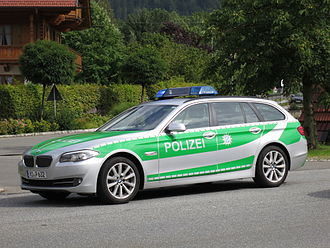 Bavarian State Police - A 2012 BMW 535d station wagon (BMW F11) with the old livery of the Bavarian Police. From September 2016, all new police cars will have the blue livery.