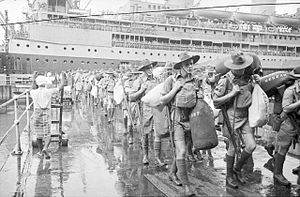 8th Division (Australia) - Members of 'C' Company, 2/30th Battalion disembark at Singapore, from Johan Van Oldenbarnevelt (HMT FF), part of Convoy US11B, 15 August 1941.