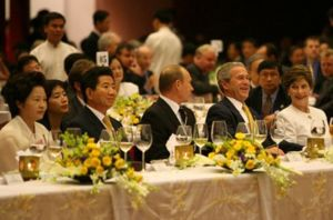 Roh Moo-hyun - Roh Moo-hyun and Kwon Yang-sook at the 2006 APEC gala dinner with President Vladimir Putin of Russia (centre) and George W. Bush and his wife Laura Bush (right)