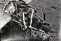 A Mechanic Works Through a Maze of Engine Parts (BOND 0288).jpg