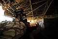 A Pakistani man operates a forklift, moving pallets of food out of the hangar to a designated spot for air transport at Pakistan Air Force Base Chaklala, Pakistan, Aug. 28, 2010, in support of flood relief 100828-F-KV470-001.jpg