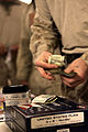 A U.S. Marine with the 2nd Battalion, 7th Marine Regiment purchases merchandise from Marines with the Warfighter Express Services Team assigned to Combat Logistics Regiment 2 at Forward Operating Base Zeebrugge 130305-M-KS710-178.jpg