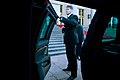 A U.S. Secret Service agent waits by the spare limousine.jpg