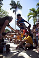 A boy at Alfonso XIII Elementary School plays a high jump game as U.S. Navy Hospital Corpsman 3rd Class Camden Boyd, sitting right, and Marine Corps Hospitalman Christopher Baldwin, sitting left, both assigned 111026-M-VG363-564.jpg