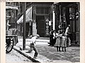 A boy runs onto the sidewalk near two girls at the corner of Broadway and Cerre.jpg