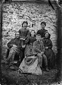A group including a man, a woman and five children NLW3364706.jpg