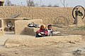 A mother and child in a typical household in the Cholistan Desert.jpg