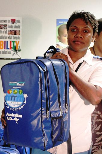 A nurse with a non-communicable diseases kit, Fiji, 2012. Photo- DFAT (13253315924).jpg