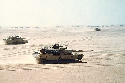 M1 Abrams move out before the Battle of Al Busayyah during the Gulf War Abrams in formation.jpg