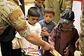 Afghan children receive school items from U.S. Soldiers with the regional communications center with Combined Joint Task Force (CJTF) 101, 101st Airborne Division and other military personnel at the El Salam 130827-A-YW808-018.jpg