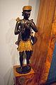 African figurine 1 on pyramid piano, MfM.Uni-Leipzig.jpg