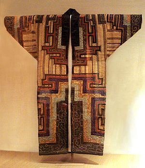 Conservation and restoration of textiles - Ainu ceremonial dress on display under glass in the British Museum.