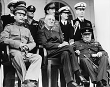 Teheran, Iran, Dec. 1943--Front row: Marshal Stalin, President Roosevelt, Prime Minister Churchill on the portico of the Russian Embassy--Back row: General H.H. Arnold, Chief of the U.S. Army Air Force; General Alan Brooke, Chief of the Imperial General Staff; Admiral Cunningham, First Sea Lord; Admiral William Leahy, Chief of staff to President Roosevelt, during the Teheran Conference
