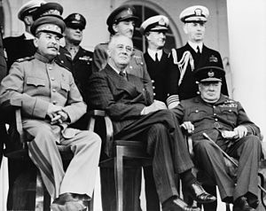 Tehran Conference - Teheran, Iran, Dec. 1943—Front row: Marshal Stalin, President Roosevelt, Prime Minister Churchill on the portico of the Russian Embassy—Back row: General H.H. Arnold, Chief of the U.S. Army Air Force; General Alan Brooke, Chief of the Imperial General Staff; Admiral Cunningham, First Sea Lord; Admiral William Leahy, Chief of staff to President Roosevelt, during the Teheran Conference
