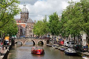 Canals of Amsterdam - Numerous tourists view Amsterdam from canal boat tours (2015)