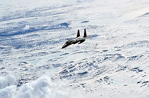 An USAF F-15C Eagle fighter flying over Iceland during an Icelandic Air Policing patrol in April 2015