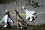An aerial view of a multinational, multiaircraft static display including, left to right, an F-4 Phantom II, an F-111, an F-15 Eagle and a Belgian Mirage DF-ST-87-10648.jpg