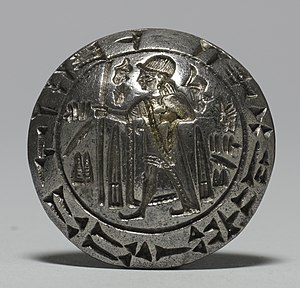 Anatolian hieroglyphs - Hittite hieroglyphs surround a figure in royal dress. The inscription, repeated in cuneiform around the rim, gives the seal owner's name: the Hittite ruler Tarkummuwa. This famous bilingual inscription provided the first clues for deciphering Hittite hieroglyphs.