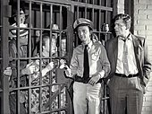 Townspeople locked in Mayberry jail.