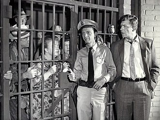 "The Andy Griffith Show - In the episode ""Andy Saves Barney's Morale"" (1961), Andy goes out of town and leaves Barney in charge. Upon returning, he finds that Barney took his job so seriously, he has put the entire population of Mayberry in jail for petty crimes."