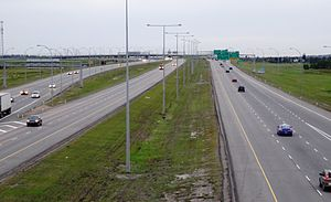 Anthony Henday Drive - Looking west on Henday toward Gateway Blvd from 91 Street. At the left, eastbound traffic from Highway 2 mixes with traffic destined to 91 Street before joining the freeway.