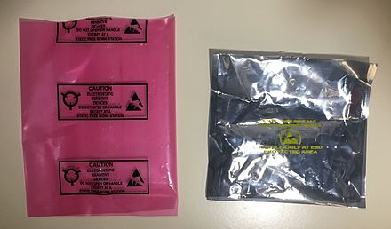 A pink static dissipative bag, and a silver conductive bag. Note the two recurring ESD symbols Antistatic Bags.jpg