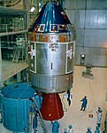Apollo 11 CSM being moved from its work stand for mating.jpg