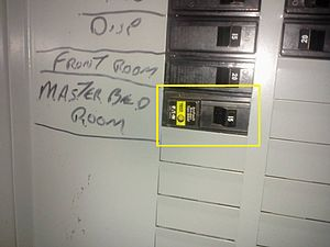 "Arc-fault circuit interrupter - This AFCI (the circuit breaker with the yellow label) is an older generation AFCI circuit breaker. The current (as of 2013) devices are referred to as ""combination type"" and usually appear with a green label."