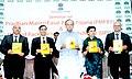"Arun Jaitley releasing a brochure at the seminar on ""Pradhan Mantri Fasal Bima Yojana (PMFBY) and Unified Package Insurance Scheme (UPIS)"", in Mumbai.jpg"