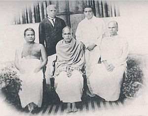 Kumaran Asan - Kumaran Asan (standing right) with Narayana Guru (seated middle).