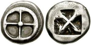 "Greek drachma - Athenian silver didrachm of ""heraldic type"" from the time of Peisistratos, 545–510 BC. Obverse: Four-spoked wheel. Reverse: Incuse square, divided diagonally"