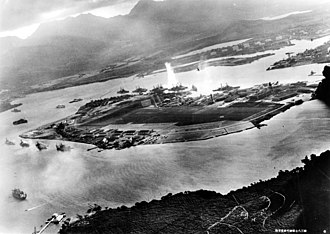 Honolulu - A view of the attack on Pearl Harbor in 1941 from Japanese planes. The torpedo explosion in the center is on the USS West Virginia.