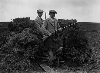 Driven grouse shooting - Gamekeeper (left) with a shooter on a driven grouse shoot in the Scottish Highlands (1922)