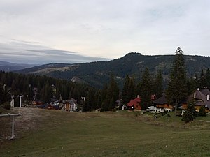 Vlašić (Bosnian mountain) - Babanovac ski track with ski-lifts and hotels at the end.
