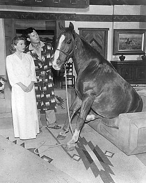 Guestward, Ho! - Bill and Babs find one of their horses prefers the ranch lobby to the barn.