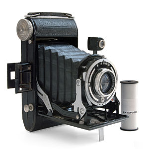 Medium format (film) - Baldafix folding camera, one of a large number of old folding cameras which used medium-format film, with a roll of 120 film
